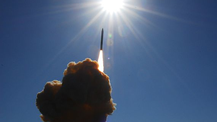 Would global nuclear disarmament increase the likelihood of global military conflict?