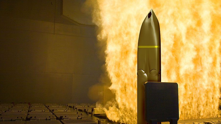 This image represents the new LRASM anti-ship missile firing from a surface warship's vertical launch system.