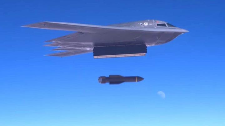 The U.S. Air Force drops a GBU-57 Massive Ordnance Penetrator (MOP) bunker-busting bomb from a B-2 stealth bomber.