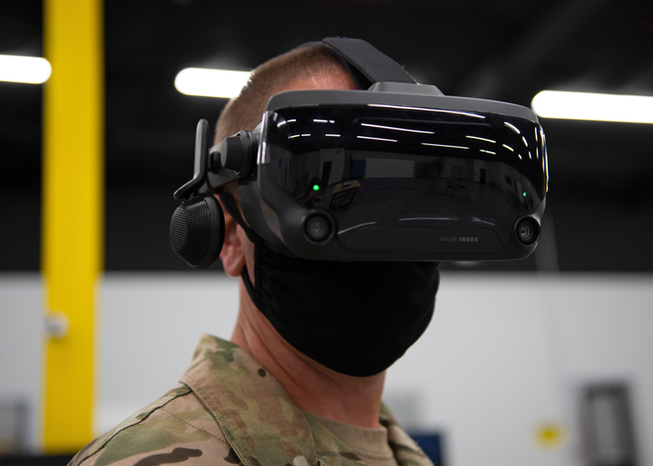 Chief Master Sgt. Courtney Freeman, 1st Special Operations Wing command chief, uses a virtual reality headset during the FieldWerx military open event in Fort Walton Beach, Fla., Aug. 24, 2020. VR is used across the force to provide training to Airmen on how to maintain aircraft, fly remotely piloted aircraft, or perform other technical tasks in a safe environment.