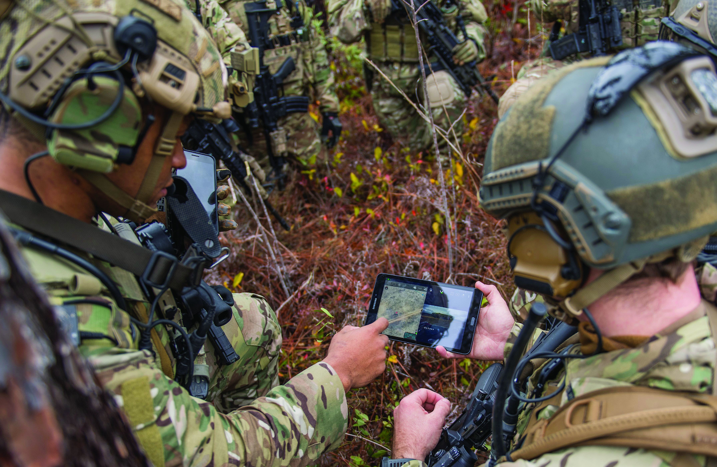 Special Operations cyber warfighters upload coordinates during an exercise showcasing the capabilities of the Advanced Battle Management System. Cyber security is crucial for sensitive battle-management systems.