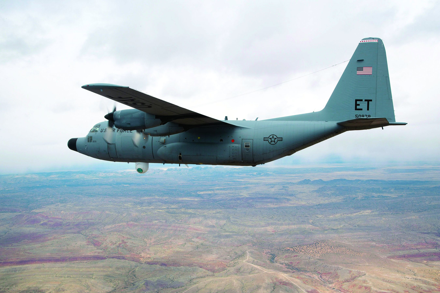 A specially modified NC-130H aircraft equipped with the Advanced Tactical Laser weapon system fired its laser while flying over White Sands Missile Range, N.M., successfully hitting a target board located on the ground.