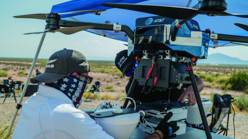 "AT&T technicians and civilian contractors assemble a ""Cell on Wings"" drone to provide 5G connectivity for the Advanced Battle Management Systems Onramp 2 at White Sands Missile Range, N.M."