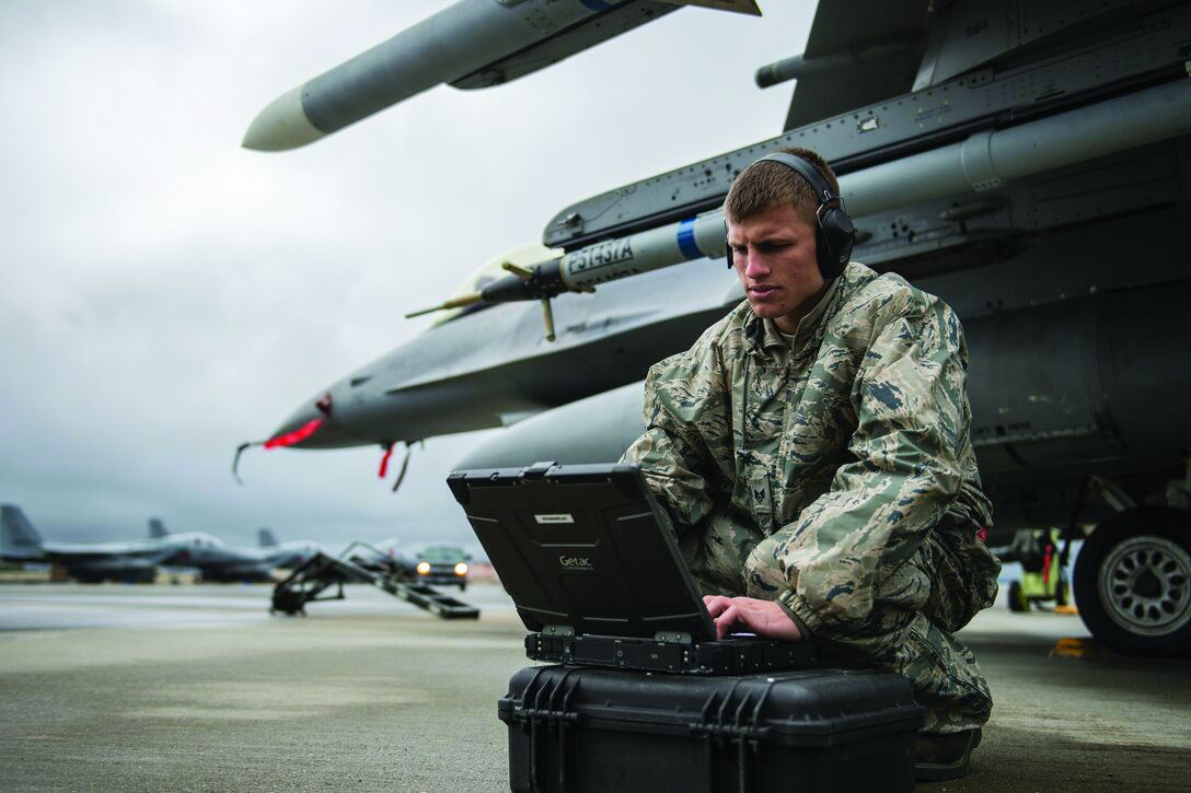 U.S. Air Force Staff Sgt. Zackery Coder checks computer data during Red Flag-Alaska 14-2, June 19, 2014, on Eielson Air Force Base, Alaska.