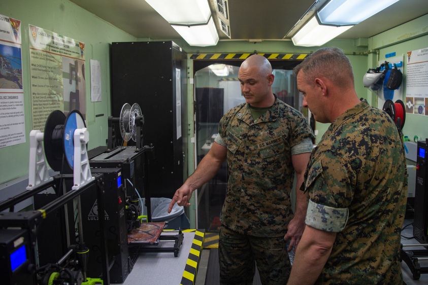 U.S. Marine Corps technicians discuss the process of producing mask frames and face shields for use in the fight against COVID-19.